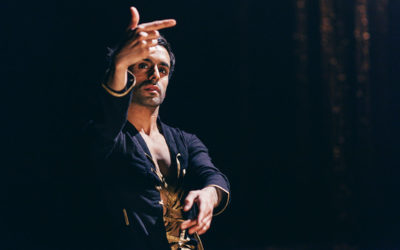 A dancer pointing his finger