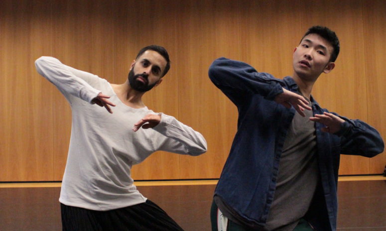 A full colour image showing Aakash Odedra and Hu Shenyuan in the studio during a rehearsal and development session.